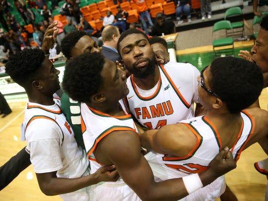Derrick Dandridge (center) is one of three players confirmed to be leaving FAMU's basketball program.