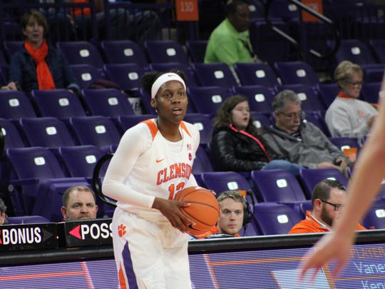 Clemson sophomore forward Aliyah Collier (12) inbounds the ball during the first quarter of Sunday's women's basketball game vs. Virginia Tech.