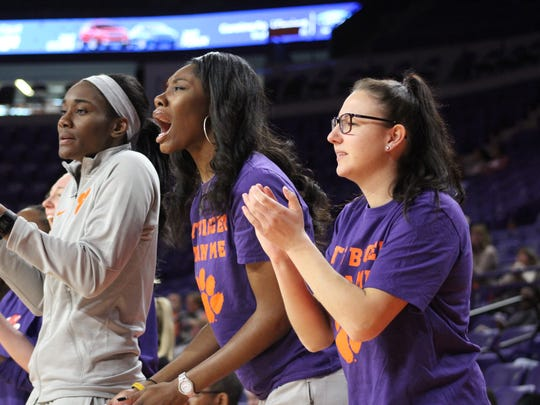 Clemson women's basketball players cheer from the bench after a made shot by one of their teammates Sunday in the third quarter of a women's basketball game against. Virginia Tech.