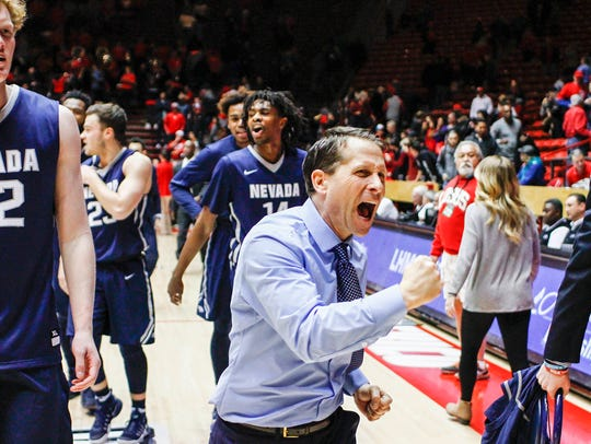 Nevada head coach Eric Musselman celebrates his team's overtime win at New Mexico in early 2017.