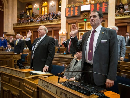 Rep. Michael Berganm and Rep. Gary Mohr take the oath