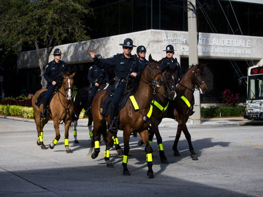 Fort Lauderdale police patrol on horseback around at the United States District Court, Southern District of Florida on Monday, January 9, 2017 in Fort Lauderdale, Fla., where Esteban Santiago made his first court appearance.