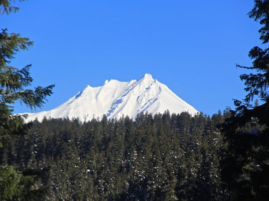 Mount Jefferson rises at a somewhat difficult-to-find viewpoint on a snowshoe trek near the upper North Santiam River.