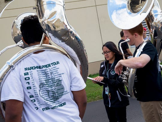 Palmetto Ridge marching band director Annabelle Sarmiento discusses line formations with her students during practice after school on Tuesday, Jan. 10, 2017. The band was selected to attend the presidential inauguration in Washington, D.C., on Jan. 20 and has recently surpassed its $135,000 fundraising goal to finance the trip.