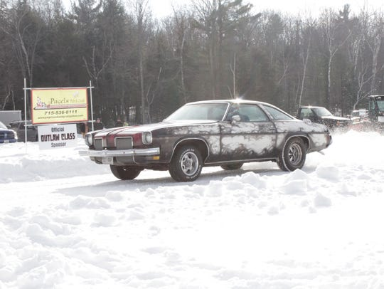 Racers at the Merrill Ice Drags compete on the one-eighth