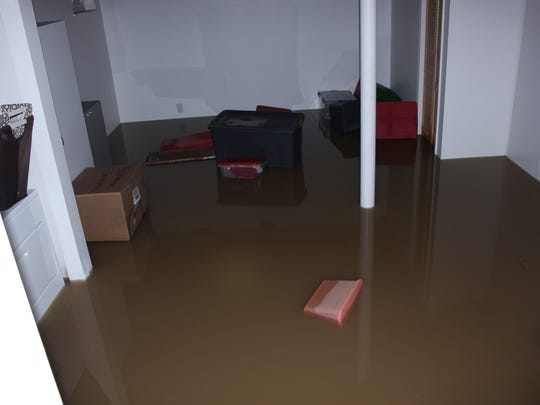 Leanna Ranieri and Kit Carson ended up with feet of water in their basement from the flooded Last Chance Ditch.