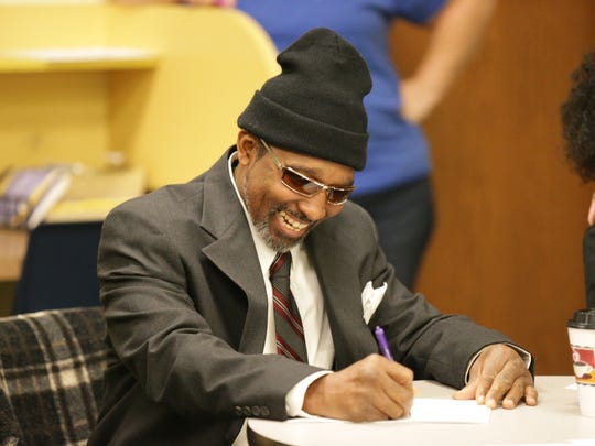 Larry Kirtley dresses to impress while studying for future job interviews with fellow Job Club members, at the John Boner Neighborhood Center, 2236 East 10th St., in Indianapolis, Jan. 13, 2017.