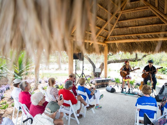 Bruce Hecksel and Julie Patchouli of the Patchouli band play in the Florida Garden during Wellness in the Garden at the Naples Botanical Gardens on Saturday, Jan. 14, 2017. Activities included local vendors on the performance lawn, educational lectures, and a variety of experiences sponsored by the Blue Zones project throughout the Gardens that increase well-being.