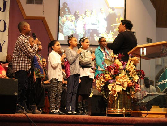 The Mansfield Community Youth Choir sings during a