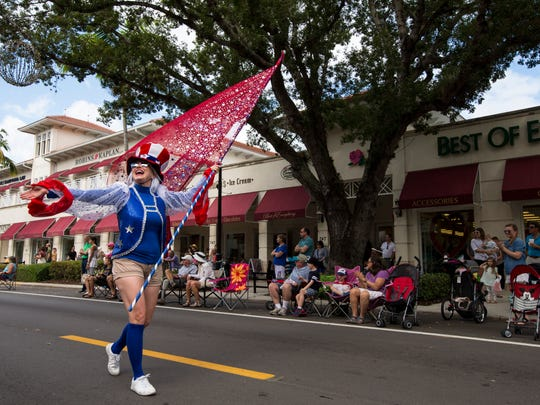 Tamara Paquette walks down Fifth Avenue South during the 20th Annual Rev. Dr. Martin Luther King Jr. Parade and Celebration in downtown Naples on Monday, Jan. 16, 2017.