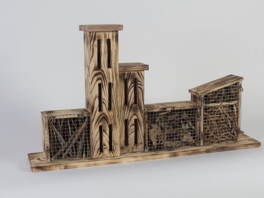 Students in the 3-D Concepts class at University of Wisconsin-Milwaukee made insect hotels from discarded wood to provide habitat for the decreasing population of bugs. Since the assignment only allowed use natural materials, Amanda Miller created designs in the wood by burning it.