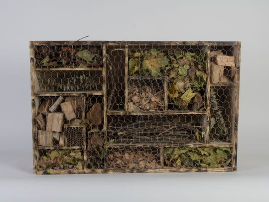 Students in the 3-D Concepts class at University of Wisconsin-Milwaukee made insect hotels from discarded wood to provide habitat for the decreasing population of bugs. Trinity Lee and Abigail Wajer-Guibord collaborated on this hotel.