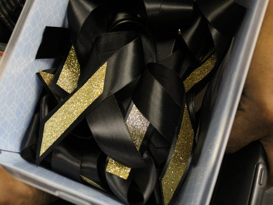 Alumni made Fair Park ribbons to pass out at the school board meeting Tuesday.