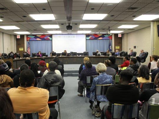A Fair Park community member speaks to board members Tuesday about saving Fair Park High School.