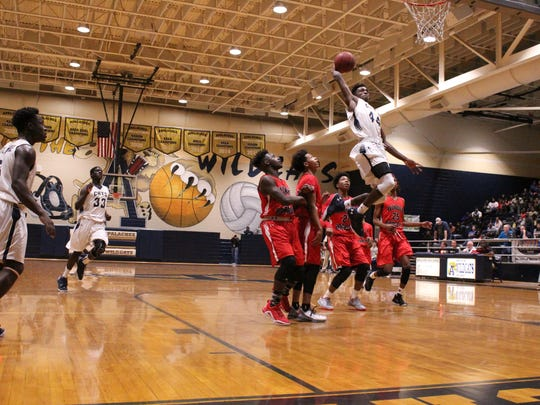 Kamar Baldwin goes up for a dunk for Apalachee High School in Georgia.