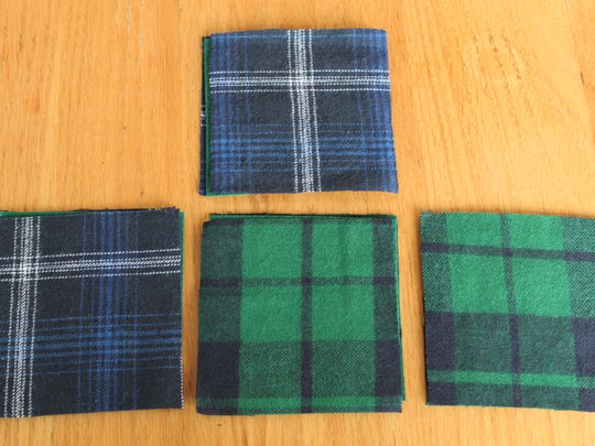 Place each felt square between two squares of fabric.