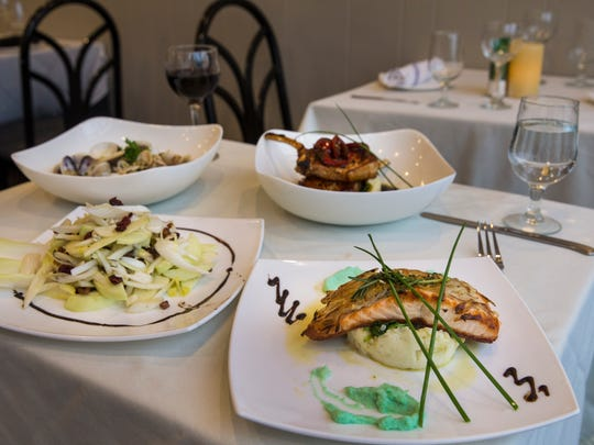 At Nonno's Italian Bistro in Bradley Beach, the menu includes (clockwise from left) a salad of green apples, endive, toasted walnuts, dried cranberries, Gorgonzola cheese and lemon vinaigrette; linguini with clam sauce; pork chops with cherry peppers, white wine and mashed potatoes; and potato-crusted salmon with cauliflower sauce and spinach.