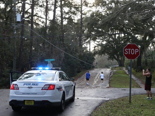 Neighborhood residents inspect the damage cause by