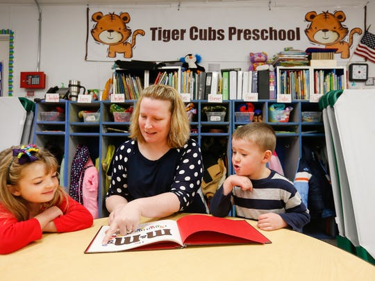 Everton preschool teacher Darla Spalding goes over colors with Ellie McGill, 5, and Weslie Vigesaa, 4, just before nap time on Tuesday, January 17, 2017.