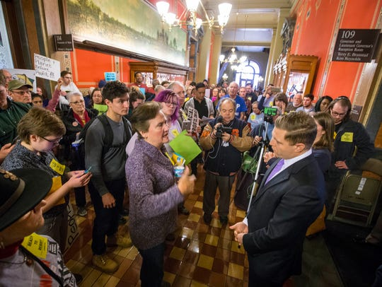 Protesters gather outside Gov. Terry Branstad's office
