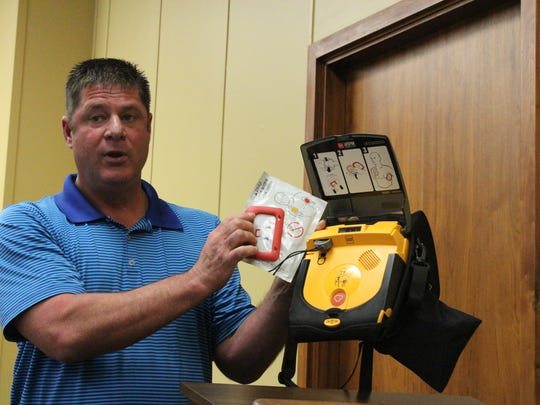 Leighton Guilbeau, a field support supervisor for a division of Acadian Ambulance, demonstrates how to use the AEDs that were given to Grant Parish law enforcement on Tuesday.