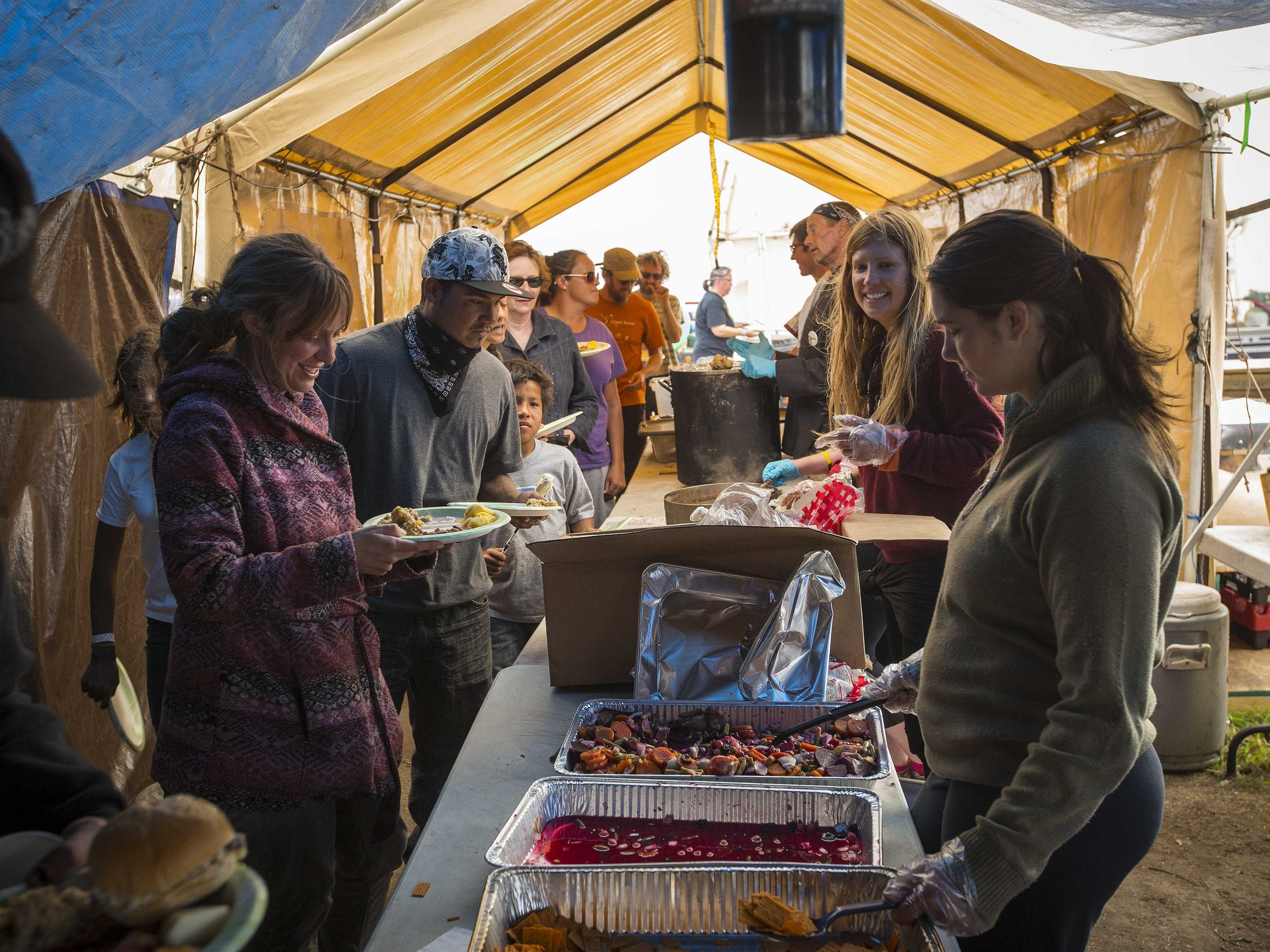 Campers line up for lunch at the Oceti Sakowin Camp