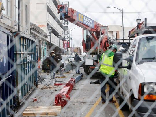 A construction crane broke causing damage to the Jim