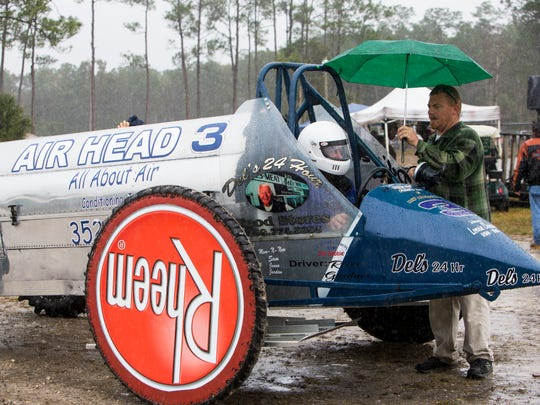 Travis Lezgus talks with Air Head driver Reese Gardner as they wait for the start of a pro-modified heat during the Budweiser Winter Classic swamp buggy races at Florida Sports Park in Naples, Florida on Sunday, Jan. 29, 2017.