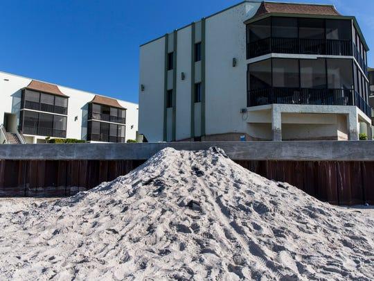 A mound of sand temporarily serves as a beach access