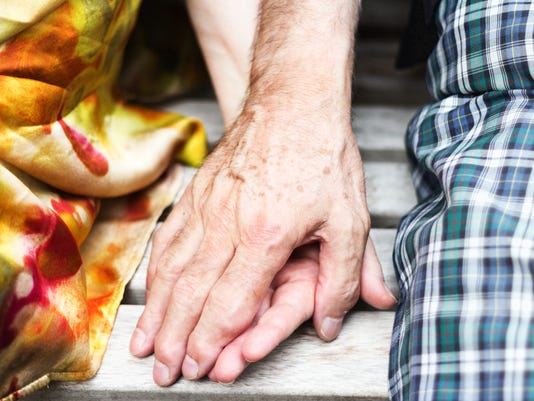 senior couple over seventy years old holding hands rheumatism care