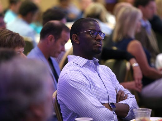 Major Andrew Gillum hears the speakers during the