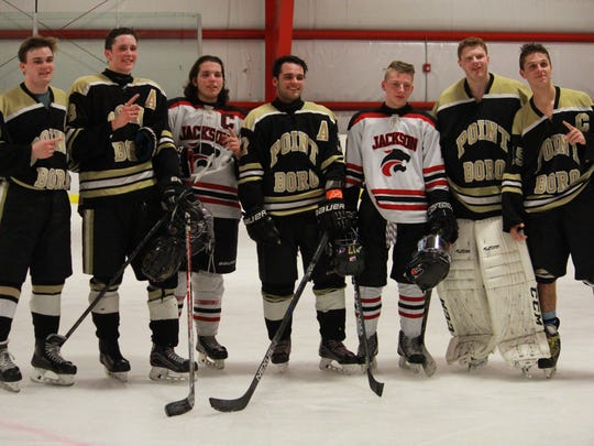 Brick Hockey Club 18UAA teammates (L to R) Dan Herrington, Ryan Carr, Trevor Cear, Cody Jablonski, Cooper Klotz and Matt Kimak after Point Boro and Jackson Memorial played on Friday at Howell Ice World.