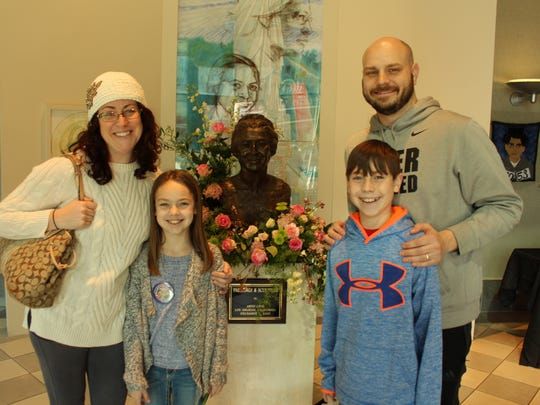 The Treen family from Huntsville — Leah and daughter Molly, Josh and son Lake — visited the Rosa Parks Museum on what would have been her 104th birthday Saturday.