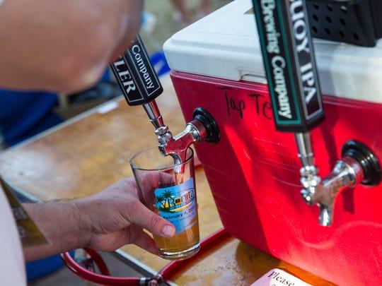 A sample of craft beer is poured during Bonita Brew Fest at Riverside Park in Bonita Springs, Florida on Saturday, Feb. 4.