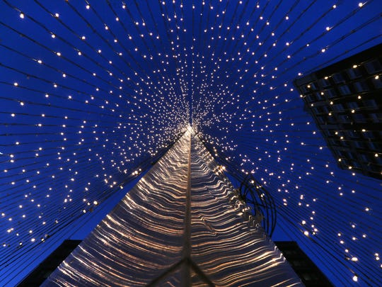 The Liberty Pole is lit up in strings of white lights in the center of Rochester earlier this month.