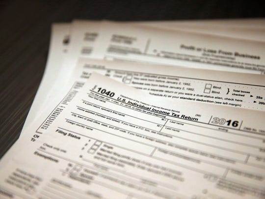 Tax forms sit on a desk at the start of the tax season