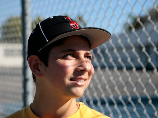 Jack Liebesman, 14, tells his story of meeting Cincinnati Reds relief pitcher Michael Lorenzen and becoming friends and throwing partners in La Jolla, Calif., on Saturday, Jan. 14, 2017. Jack tells the story that Lorenzen saw him and his brother Troy, a college ballplayer, on the sidewalk from his car and rolled down his window to ask if they played baseball. After introducing himself as a Major League Baseball player, the brothers were happy to join in Lorenzen's throwing routine.