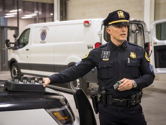 DMPD's  Sgt. Ryan Doty shows the new wearable camera during a demonstration of both the body worn camera and in-car video system used by the Des Moines Police Department Tuesday Feb. 7, 2017, The cameras are synced to the in car video system, starting recording on each camera when the record button is pressed. The high definition panoramic footage from the cameras is downloaded and stored automaticaly when the camera is placed in its charging station.