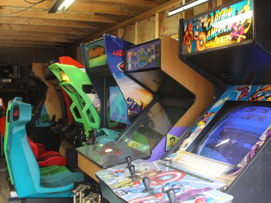 Adam Lamb's home workshop where he fixes and stores arcade games on Feb. 6, 2017.