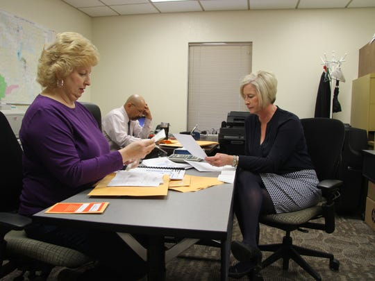Eddy County Clerk Robin Van Natta (left) discuss Loving