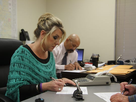 Carlsbad assistant superintendent Kelli Barta calculates the total votes from the school board election during the canvassing process Wednesday.