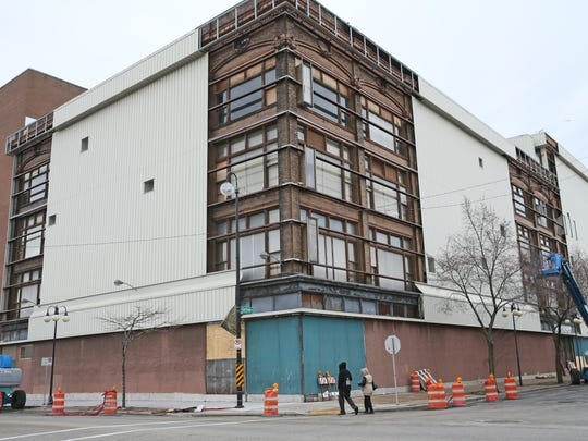 The former Schuster's department store on North King Drive will be redeveloped. This 2015 photo shows the temporary removal of the building's metal-clad siding to inspect the building's brick exterior.