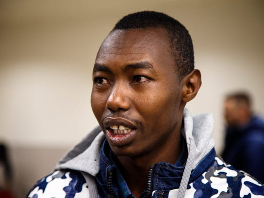 Yakub Musa and his family arrive at the Des Moines Airport Thursday, Feb. 9, 2017. The family of eight Somalis arrived in Iowa after nine years in a refugee camp.