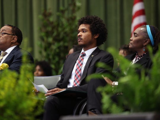 Student Government Association President Justin Bruno sits on stage during the African-American History Month Convocation at the Gaither Gym on FAMU's campus Friday, Feb. 10, 2017.