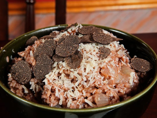 Red Wine Risotto is topped with shaved truffles.