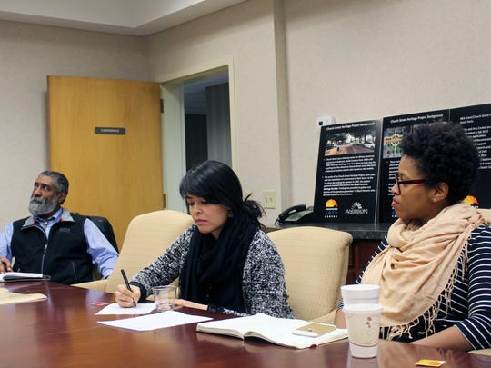 Bob Reeder, left, a rural program manager with the Local Initiatives Support Corp., Rebecca Chan, center, a program manager with a national creative placemaking program, and consultant Jessica Solomon listen to a presentation Tuesday about the Church Street Heritage Project in downtown Anderson.