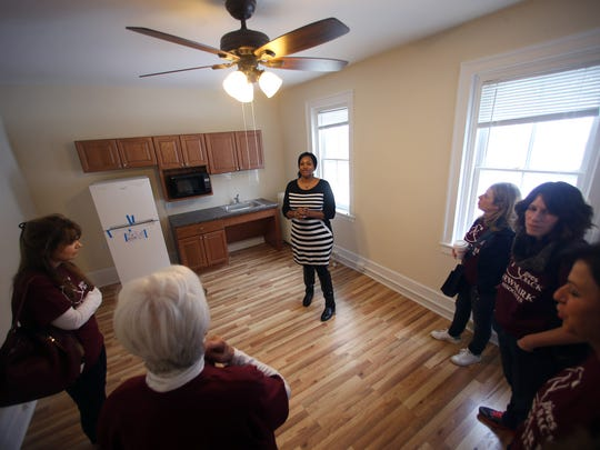 Mt. Kemble Home Manager Elizabeth Johnson gives a tour to to Valentine volunteers from Newmark Associates of residents rooms as they put the finishing touches on the $1.5M renovation project that was completed last year at the historic landmark offering affordable housing to senior women in Morristown. February 14, 2017, Morristown, NJ.