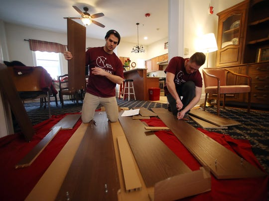 Valentine volunteers Charles Ritschel, l, and John Koch join co-workers from from Newmark Associates putting the finishing touches on the $1.5M renovation project that was completed last year at the Mt. Kemble Home, a historic landmark offering affordable housing to senior women in Morristown. February 14, 2017, Morristown, NJ.