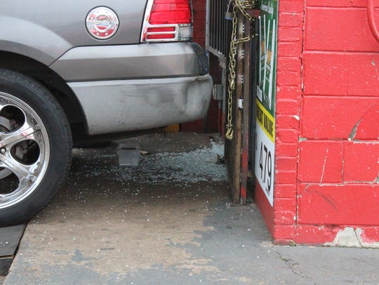 Shattered glass remained on the ground outside the Chi-Town Gas & Grocery convenience store on Feb. 15, the day after a shooting claimed the life of 27-year-old Thaer Zidan. The man accused in the slaying, 25-year-old Timothy Teasley, has been committed to a mental-health facility after he was found incapable of assisting his defense attorneys.