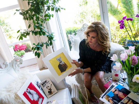 Amy Brazil discusses her paintings and prints at her home in Naples, Florida on Wednesday, Feb. 15, 2017. Brazil is well-known for her extravagant and realistic paintings of dogs, which often incorporate Swarovski crystals, various metals, and semi-precious gemstones.